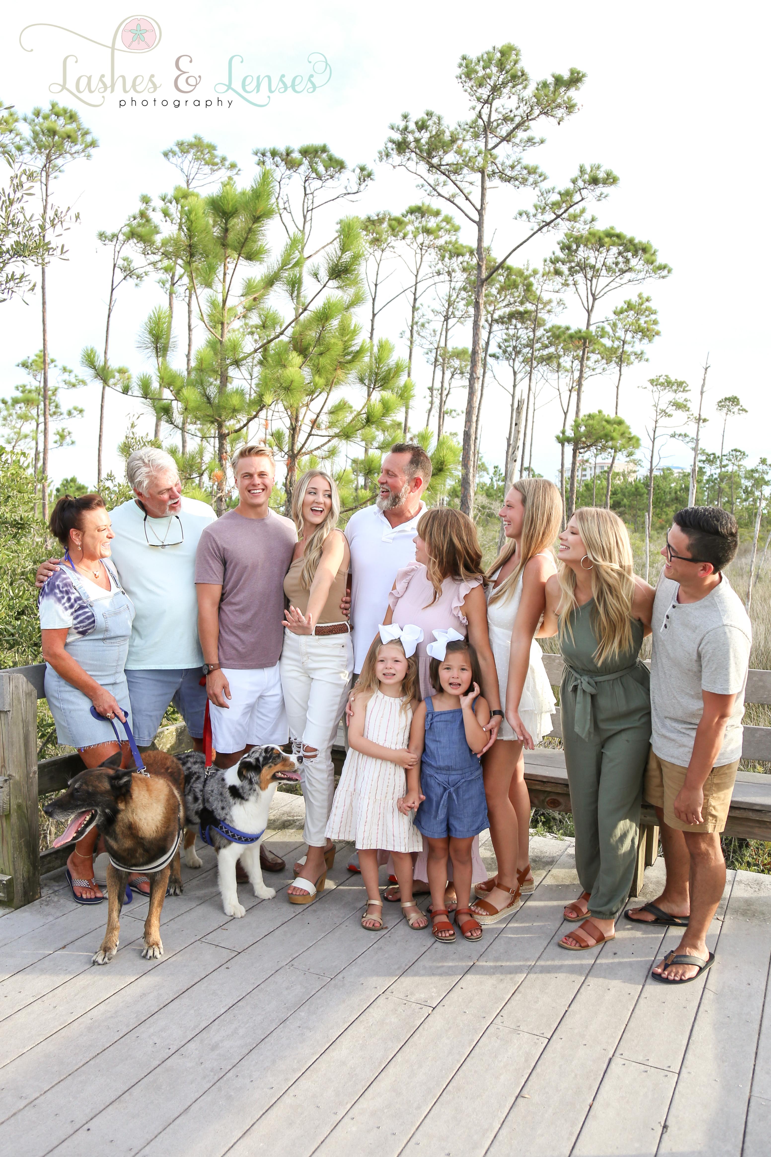 Whole family celebrating the newly engaged couple on nature trail at Johnsons Beach Perdido Key