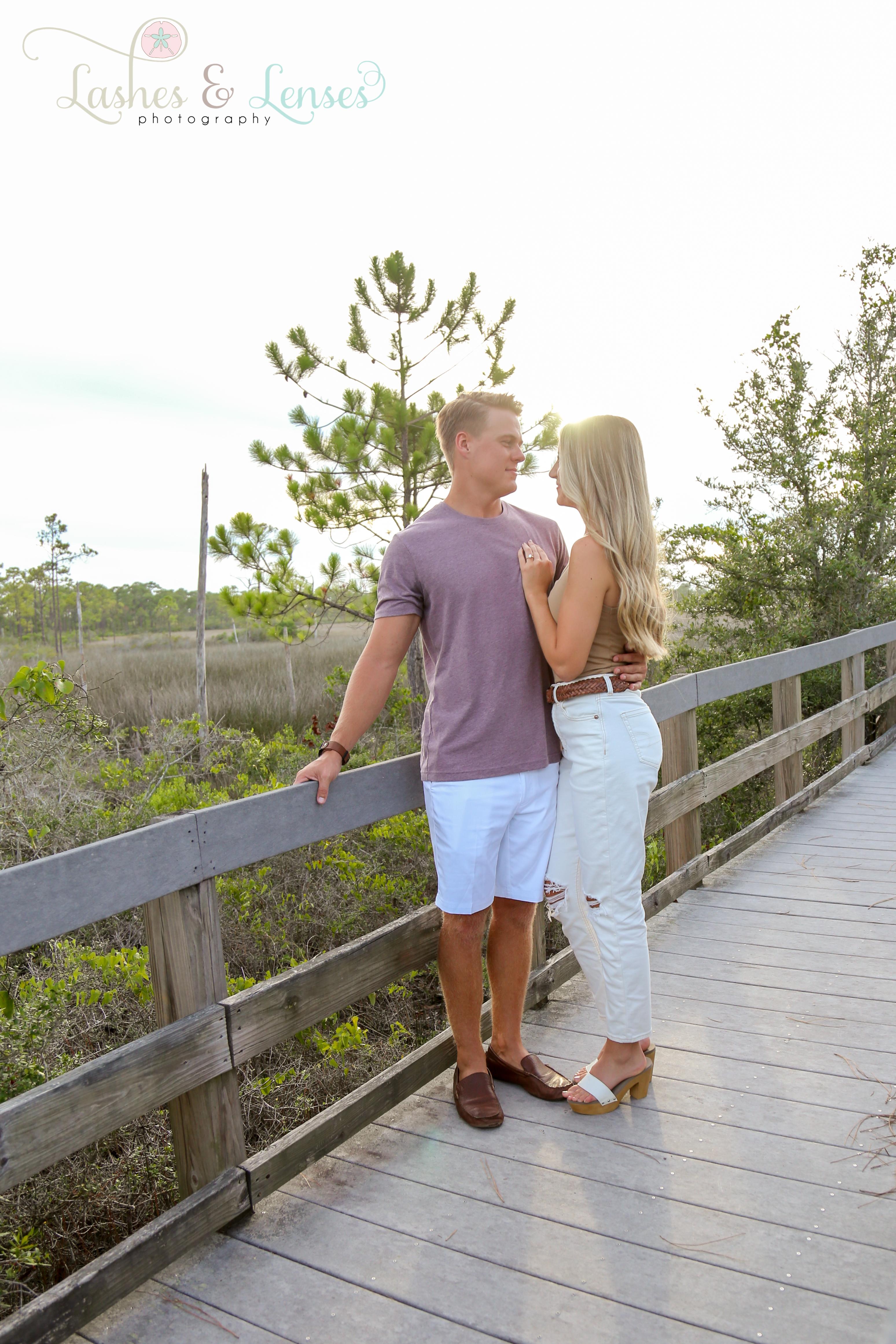 Engaged couple on nature trail at Johnsons Beach Perdido Key