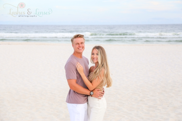 Young couple posing with water behind them at Johnsons Beach Perdido Key