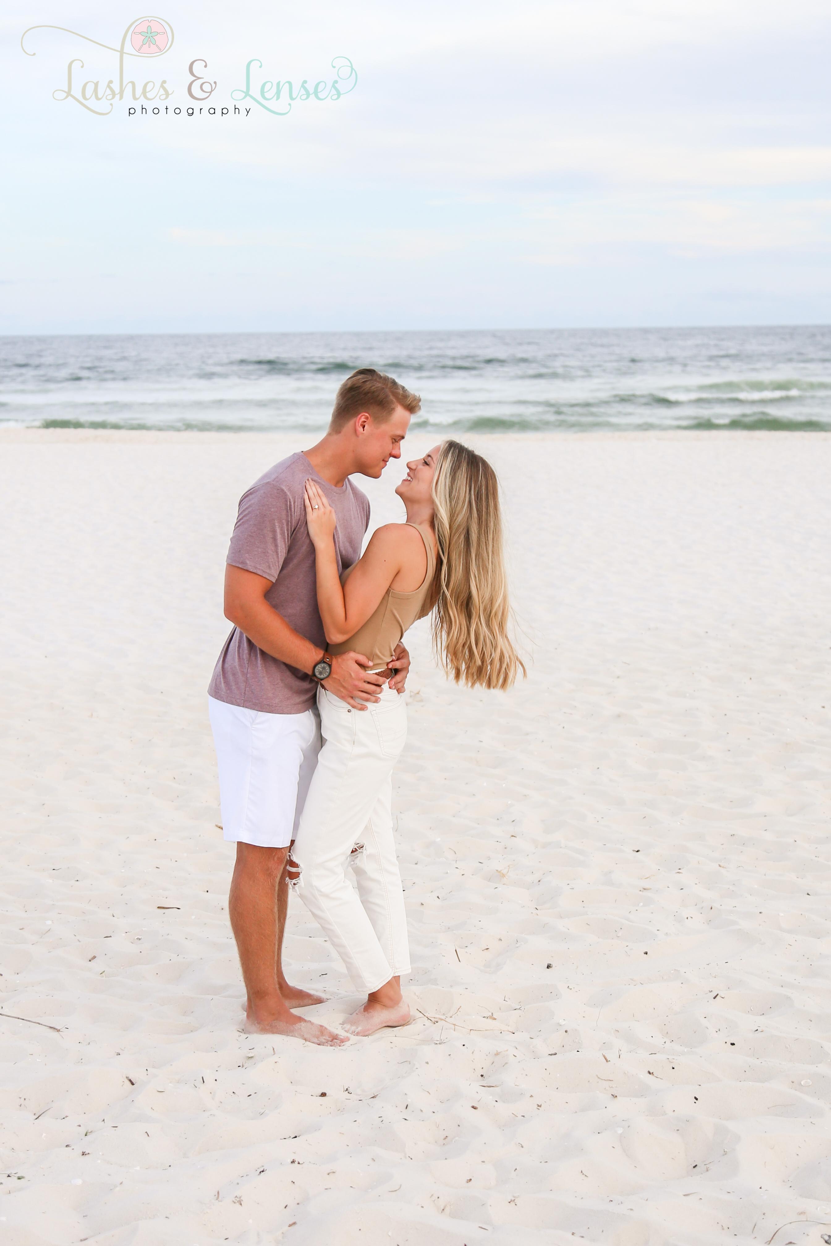 Engagement pose at Johnsons Beach Perdido Key