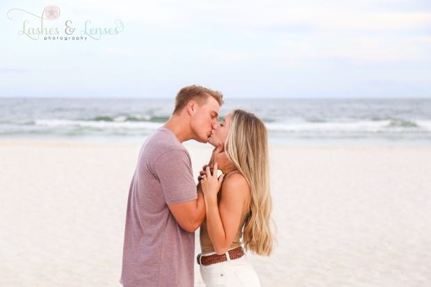 Newly engaged couple on the beach at Johnsons Beach Perdido Key