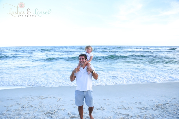 Dad with baby boy standing by the water Beach Colony Condo in Perdido Key
