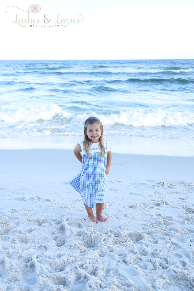 Little girl standing by the water Beach Colony Condo in Perdido Key