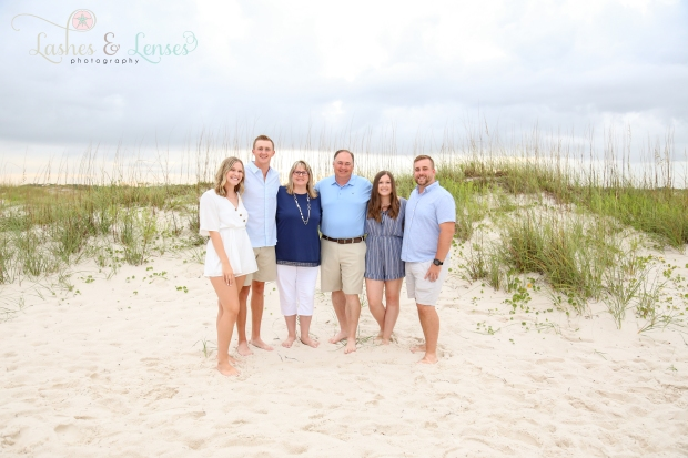 Whole family by a sand dune at Johnsons Beach in Perdido Key