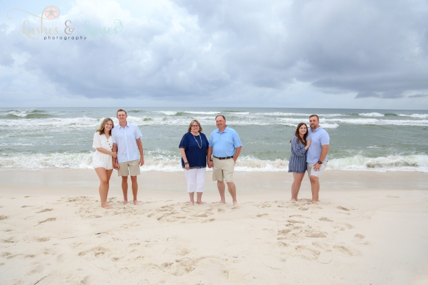Family down by the water at Johnsons Beach in Perdido Key