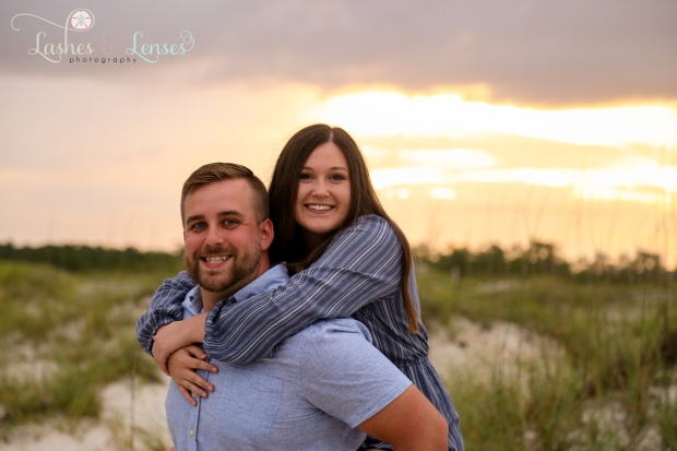 Couple with the sunset behind of them at Johnsons Beach in Perdido Key