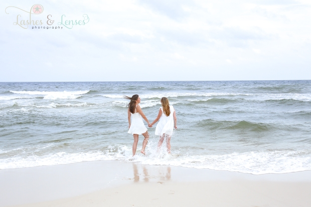 Two senior girls playing in the water at Johnsons Beach in Perdido Key