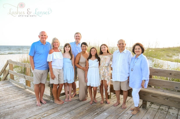 Large family standing on the boardwalk at Johnson Beach Perdido Key