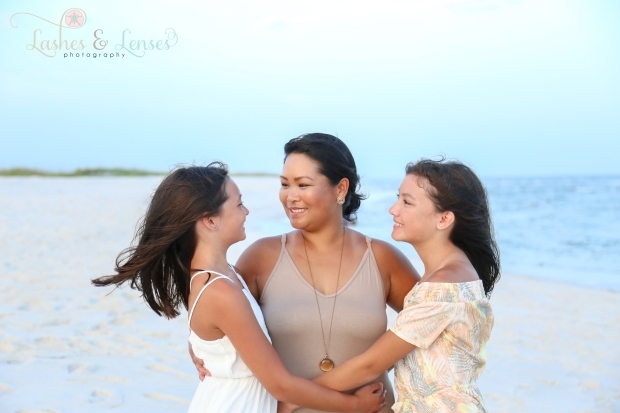 Mom with her two daughters by the waters edge at Johnson Beach Perdido Key