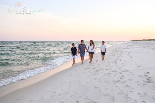 Whole family walking by the gulf at Johnsons Beach in Perdido Key