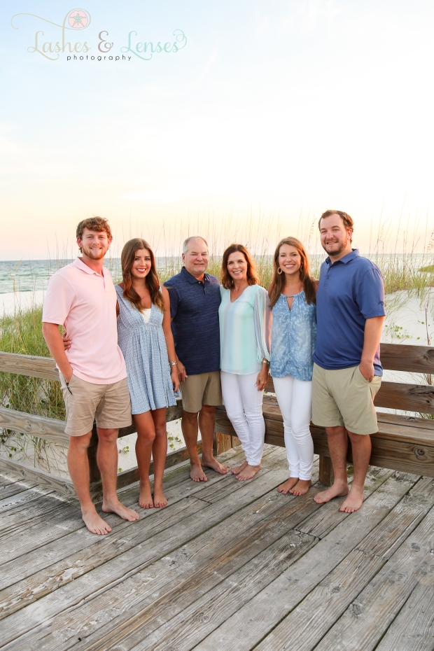 Family with adult children and spouses on the boardwalk at Johnsons Beach in Perdido Key