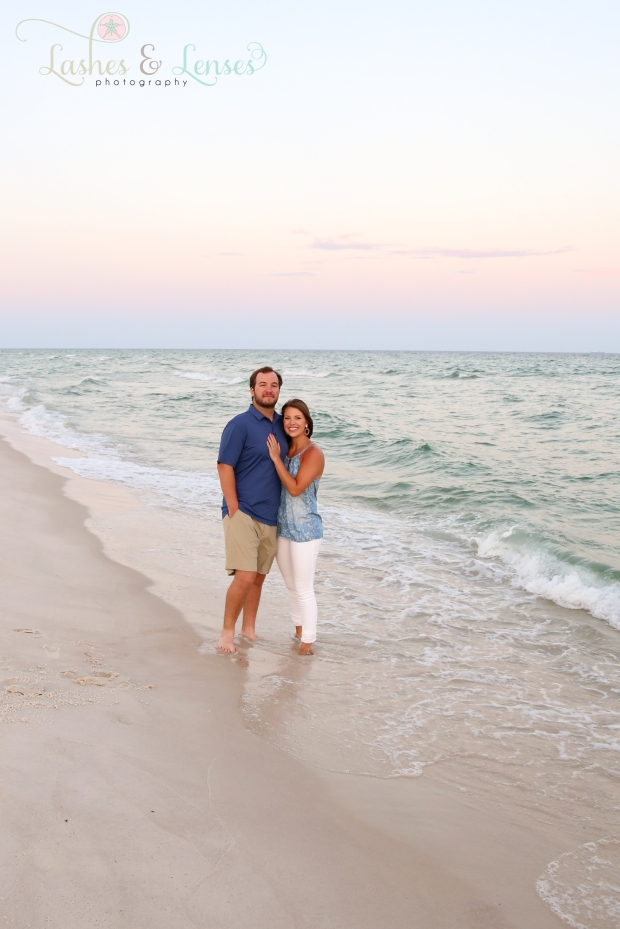 Young adult couple posing by the water at Johnsons Beach in Perdido Key