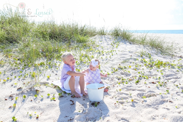 Brother and Sister in the sand playing with bucket at Johnsons Beach in Perdido Key