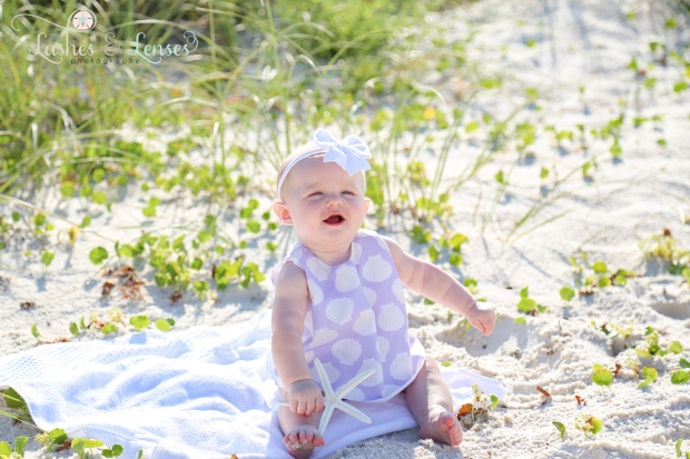 Baby girl playing in the sand at Johnsons Beach in Perdido Key