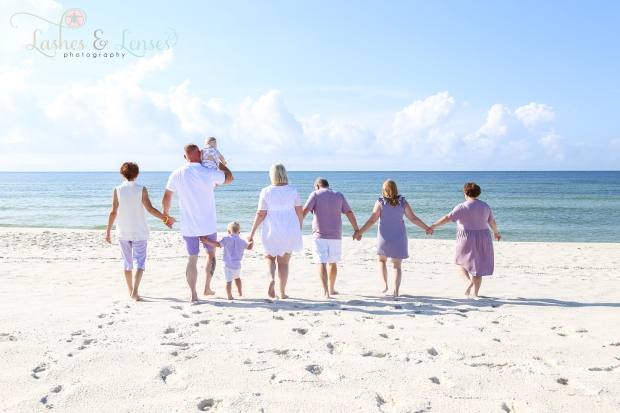 Whole Family walking down to the water at Johnsons Beach in Perdido Key