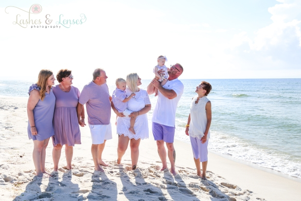 Family by the water at Johnsons Beach in Perdido Key