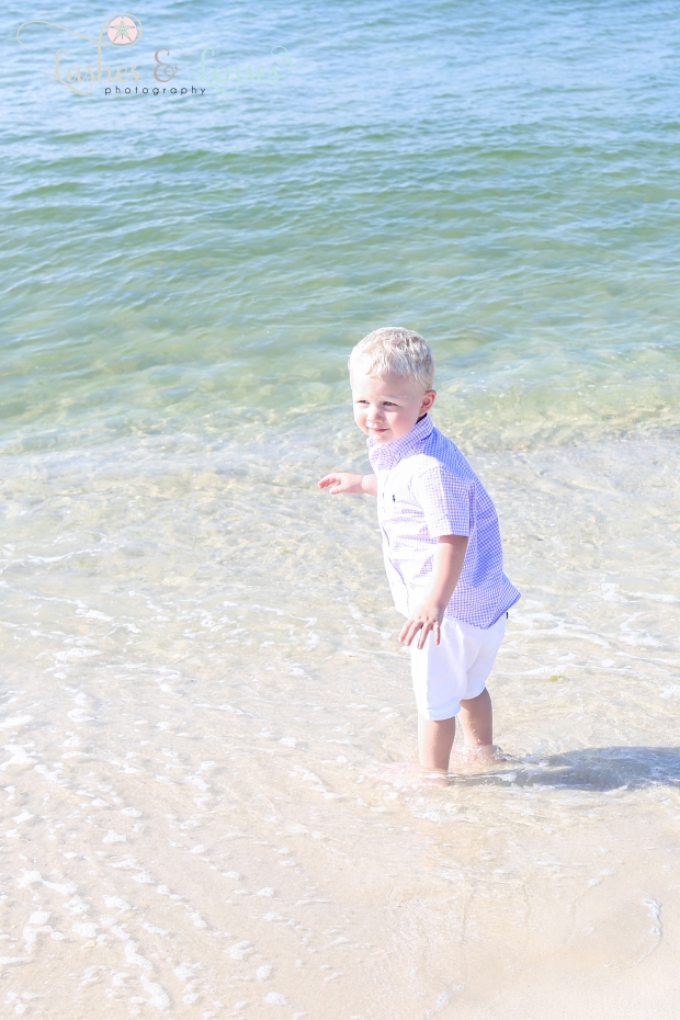 Little boy playing in the water at Johnsons Beach in Perdido Key