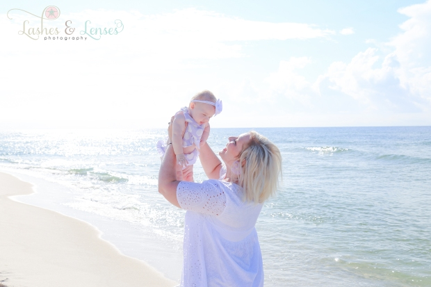 Mom and Baby girl next the water at Johnsons Beach in Perdido Key