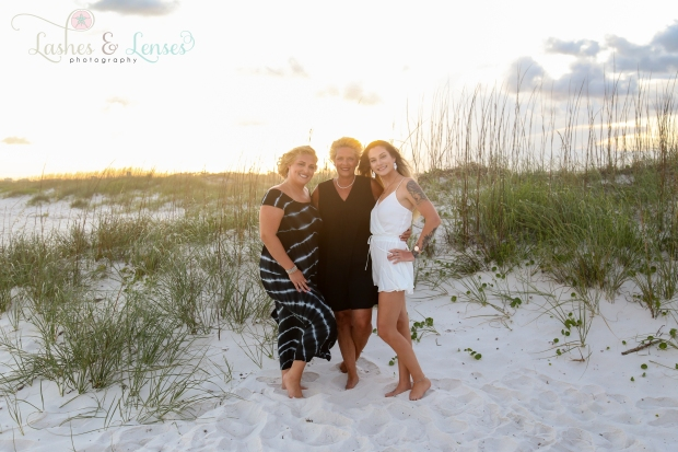 Mom with two adult daughters by a sand dune at Johnsons Beach Perdido Key