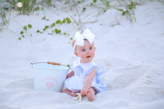 Baby girl sitting in the sand with monogramed bucket on the beach at Johnsons Beach in Perdido Key