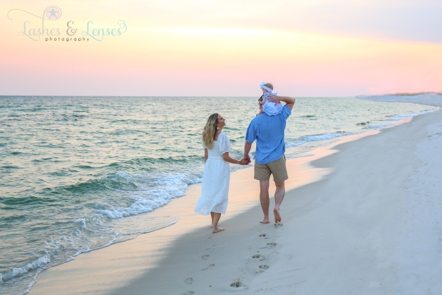 Family walking on the beach on the beach at Johnsons Beach in Perdido Key