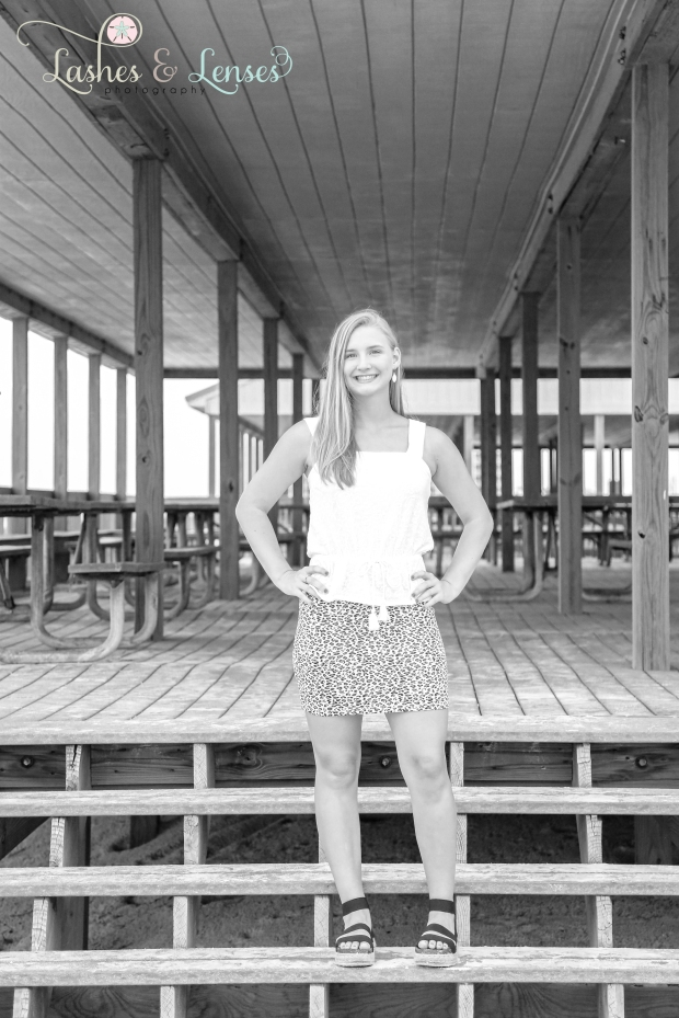 Senior Girl portrait standing on the pavilion at Johnson's Beach in Perdido Key