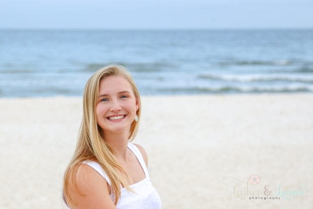 Senior Girl close up portrait standing on the sand at Johnson's Beach in Perdido Key