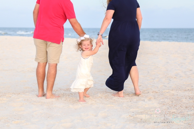 Little family walking down to the water at Johnsons Beach in Perdido Key
