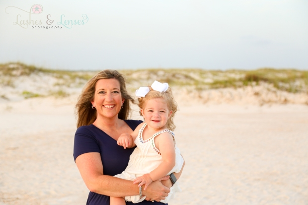 Mom holding toddler daughter on the beach at Johnsons Beach in Perdido Key
