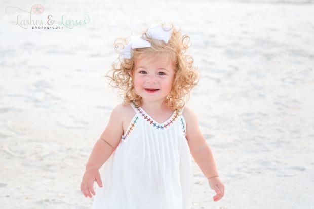 Little girl standing on the beach at Johnsons Beach in Perdido Key