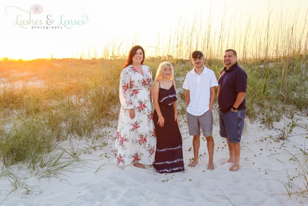 Family with teenage daughter and teenage son standing in the sand dunes at Johnsons Beach in Perdido Key