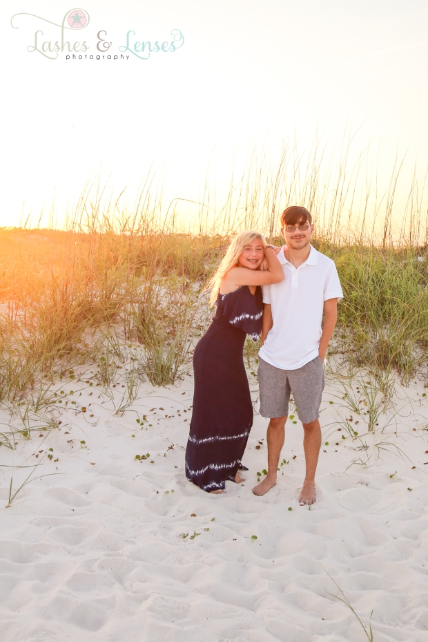 Teenage brother and sister standing in the sand at Johnsons Beach in Perdido Key