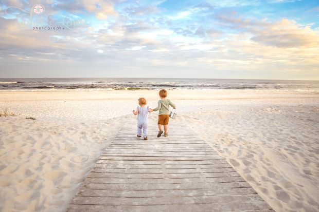 Toddler siblings on the boardwalk at Johnsons Beach in Perdido Key