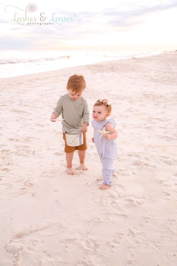 Brother and sister playing in the sand at Johnsons Beach in Perdido Key