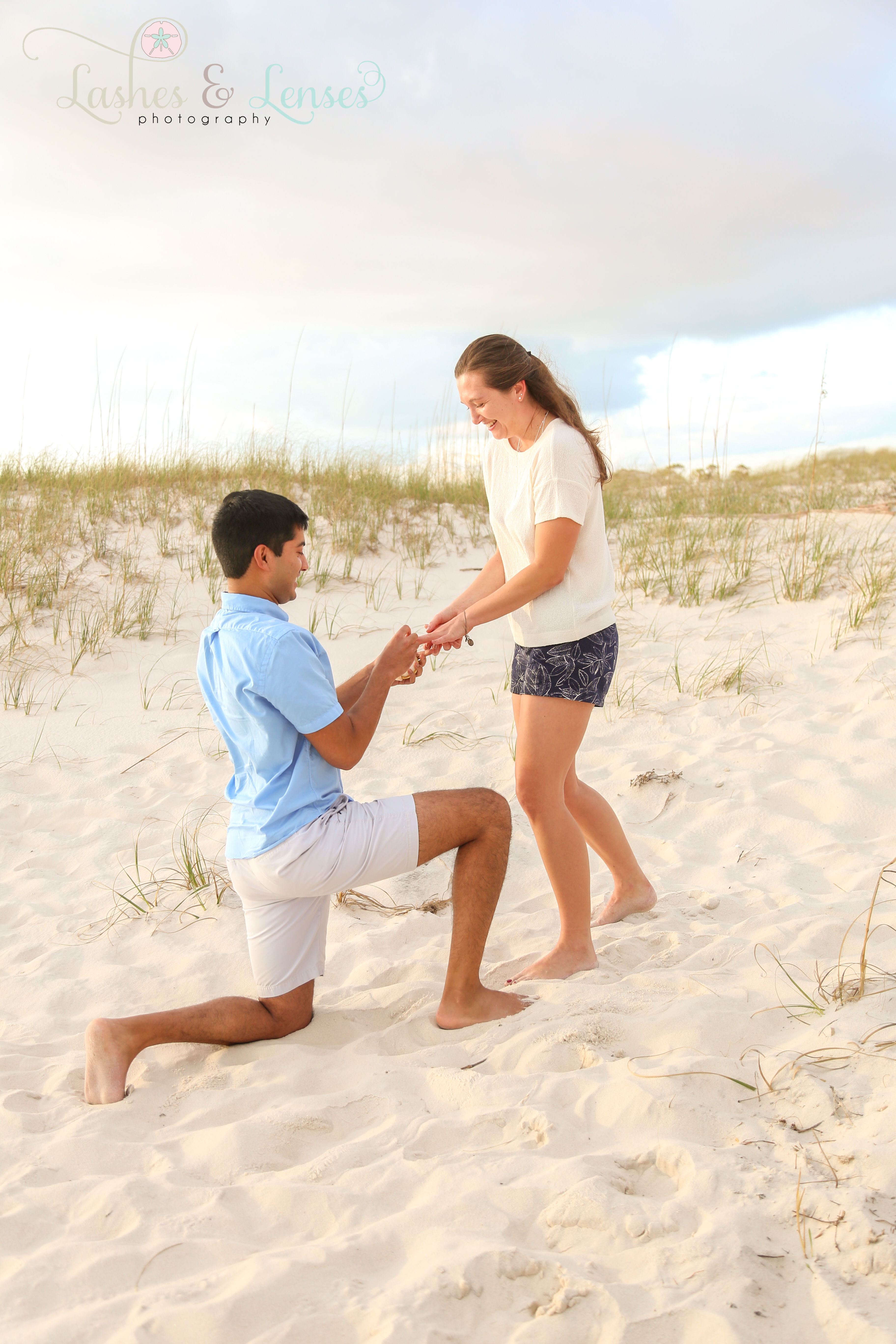 Young man proposing to girlfriend on the beach at Johnson's Beach in Perdido Key