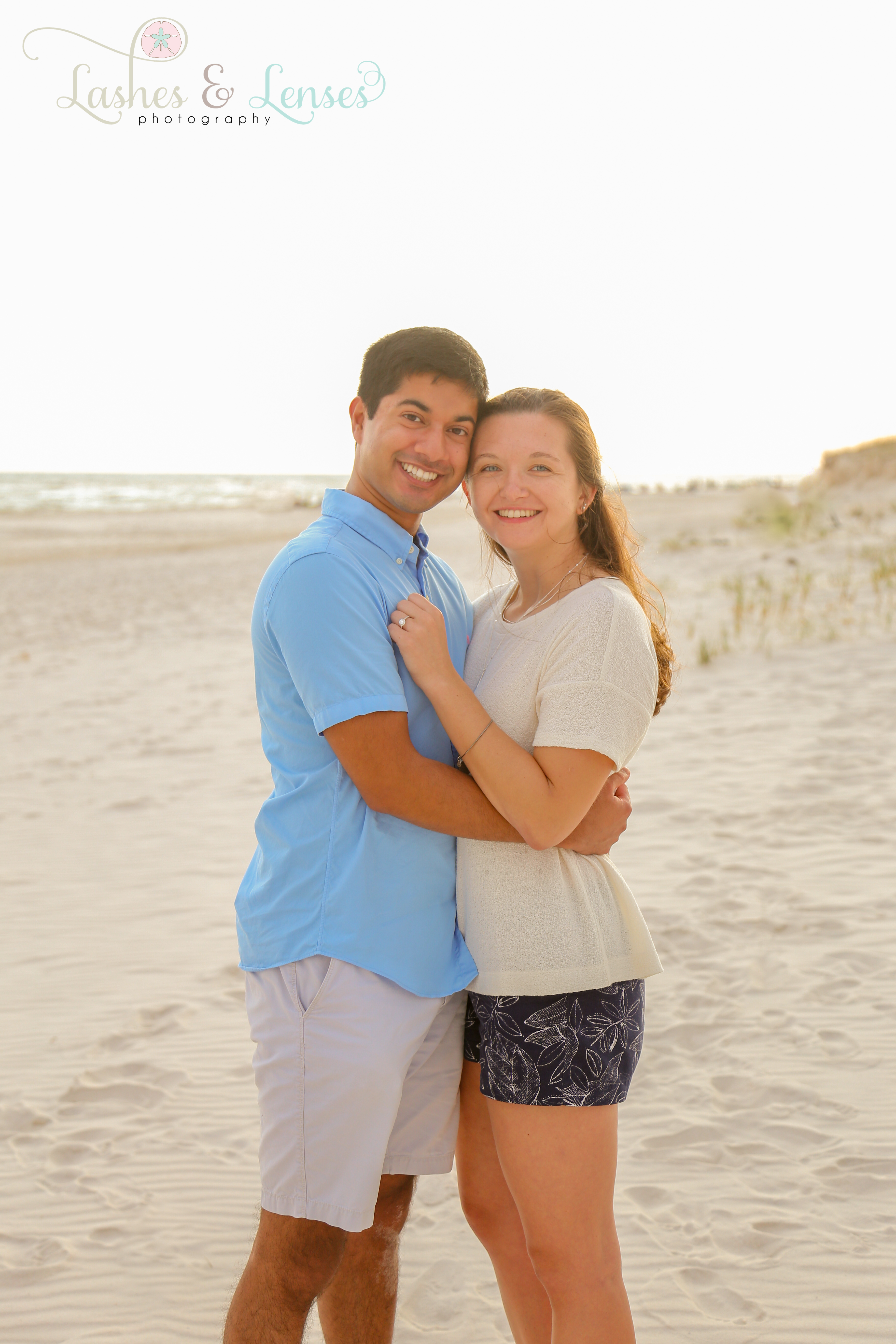 Couple posing on the beach at Johnson's Beach in Perdido Key