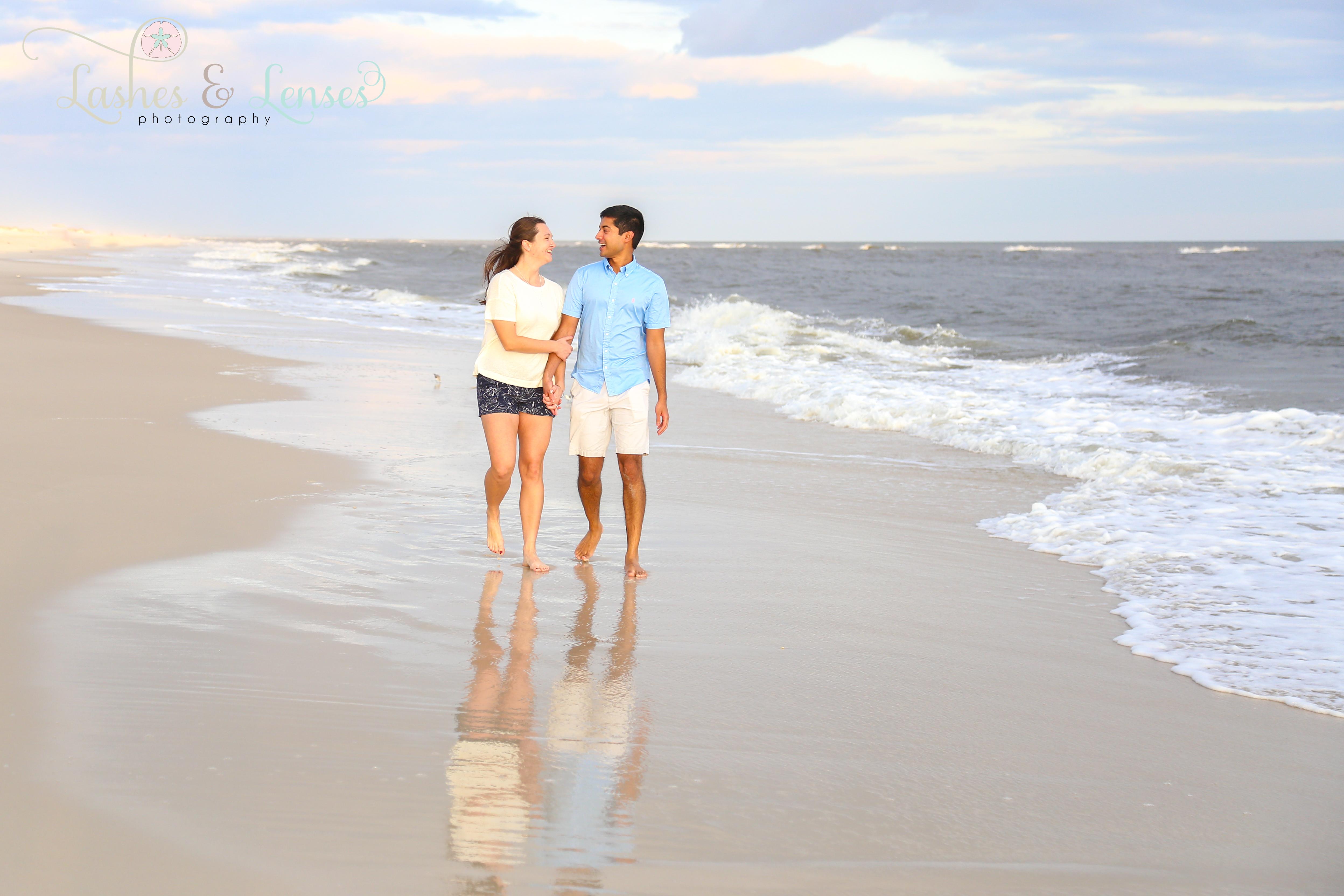 Couple walking on the beach at Johnson's Beach in Perdido Key