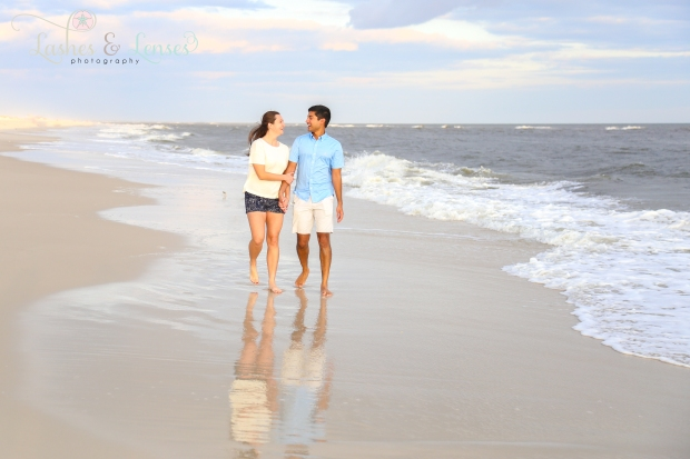 Couple walking on the beach at Johnson's Beach in Perdido Key