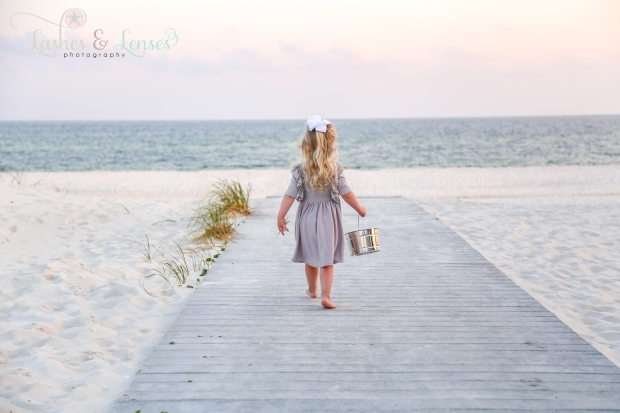 Little girl walking on boardwalk at Johnson's Beach in Perdido Key