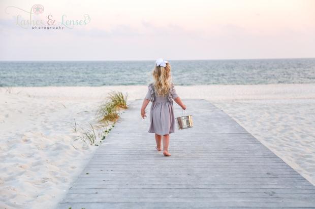 Little girl walking on boardwalk at Johnson's Beach in Perdido Key