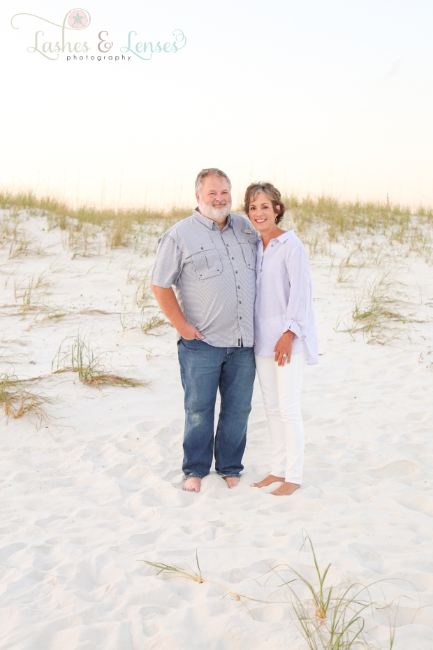 Mature Couple standing by the sand dunes at Johnsons Beach in Perdido Key