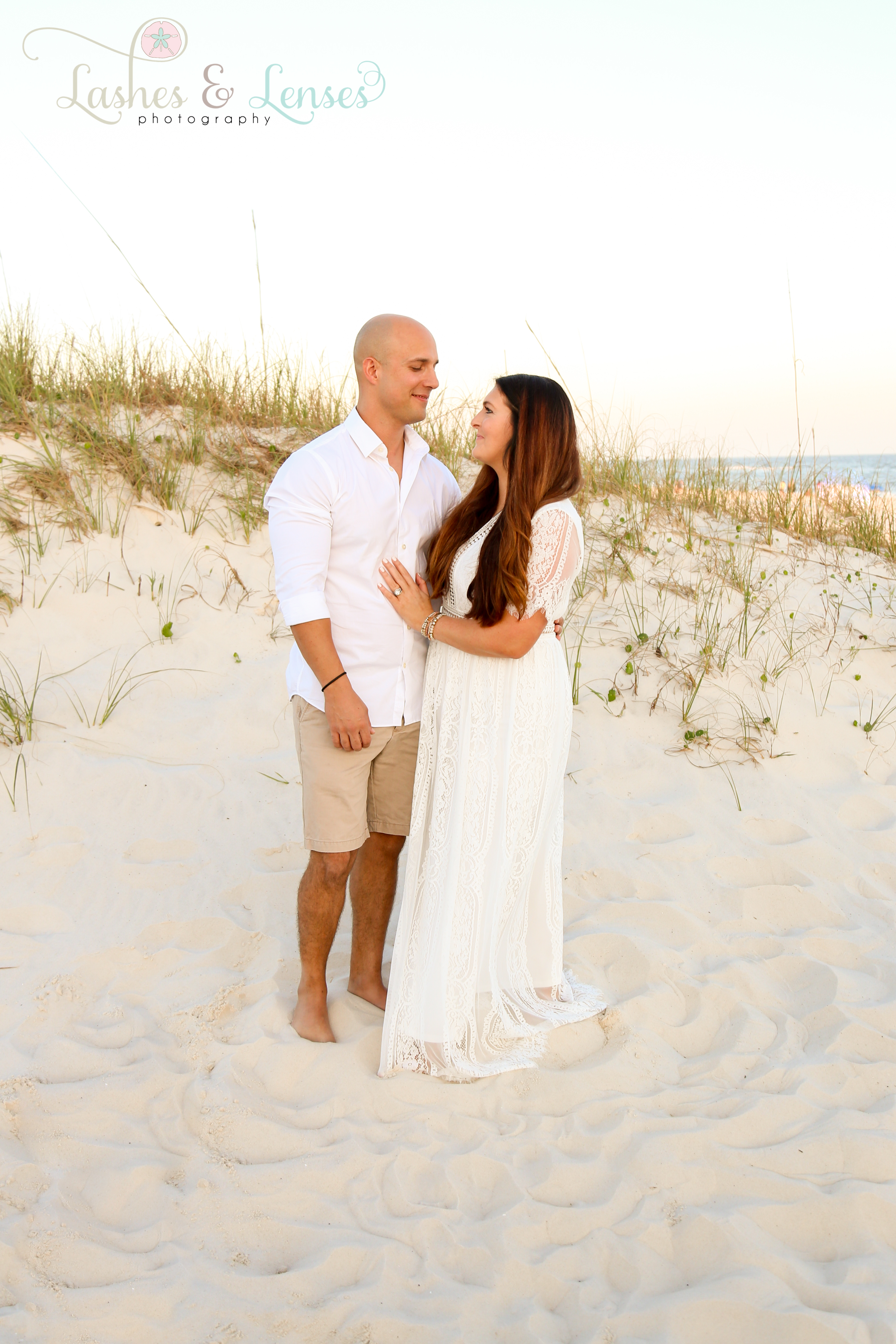 Couple standing by the sand dunes at Johnsons Beach in Perdido Key
