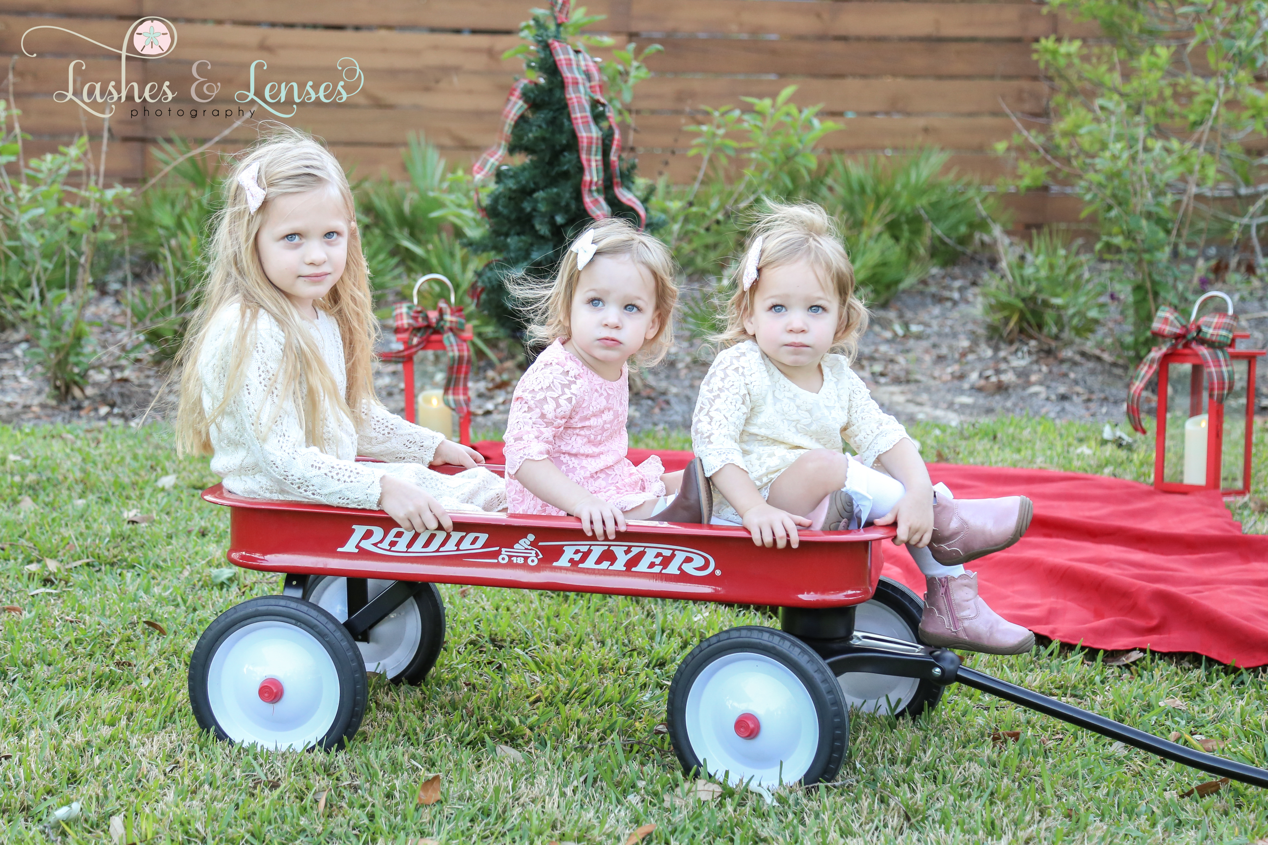 Pre-K girl and twin toddler sisters in the radio flyer wagon with Christmas tree at Innerarity Point Park