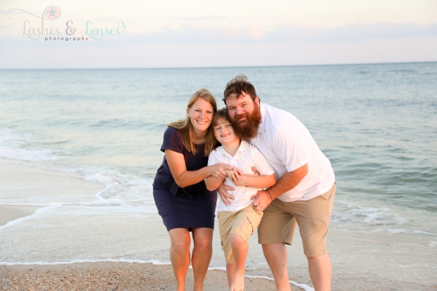 Little family by the waters edge at Johnsons Beach in Perdido Key