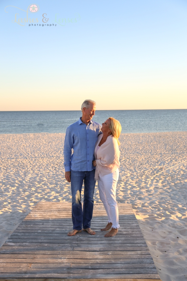 Couple standing on boardwalk looking at each other at Johnsons Beach in Perdido Key