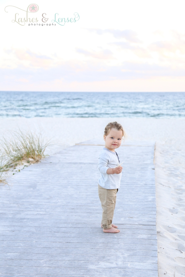 Toddler boy on the boardwalk at Johnsons Beach in Perdido Key