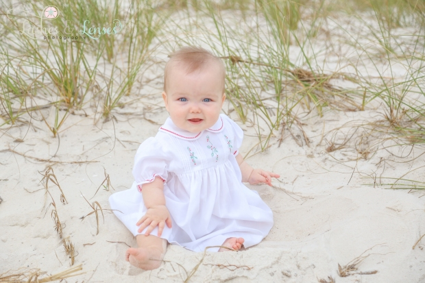 Little girl sitting in the sand at Johnsons Beach in Perdido Key