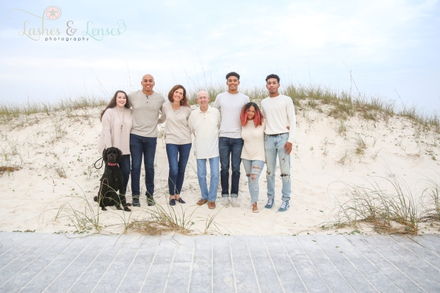Extended family with grandfather in the sand dunes at Johnsons Beach in Perdido Key