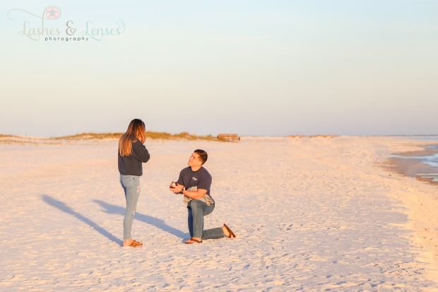 Young Man proposing to girlfriend of 8 years on the beach at Johnsons Beach in Perdido Key