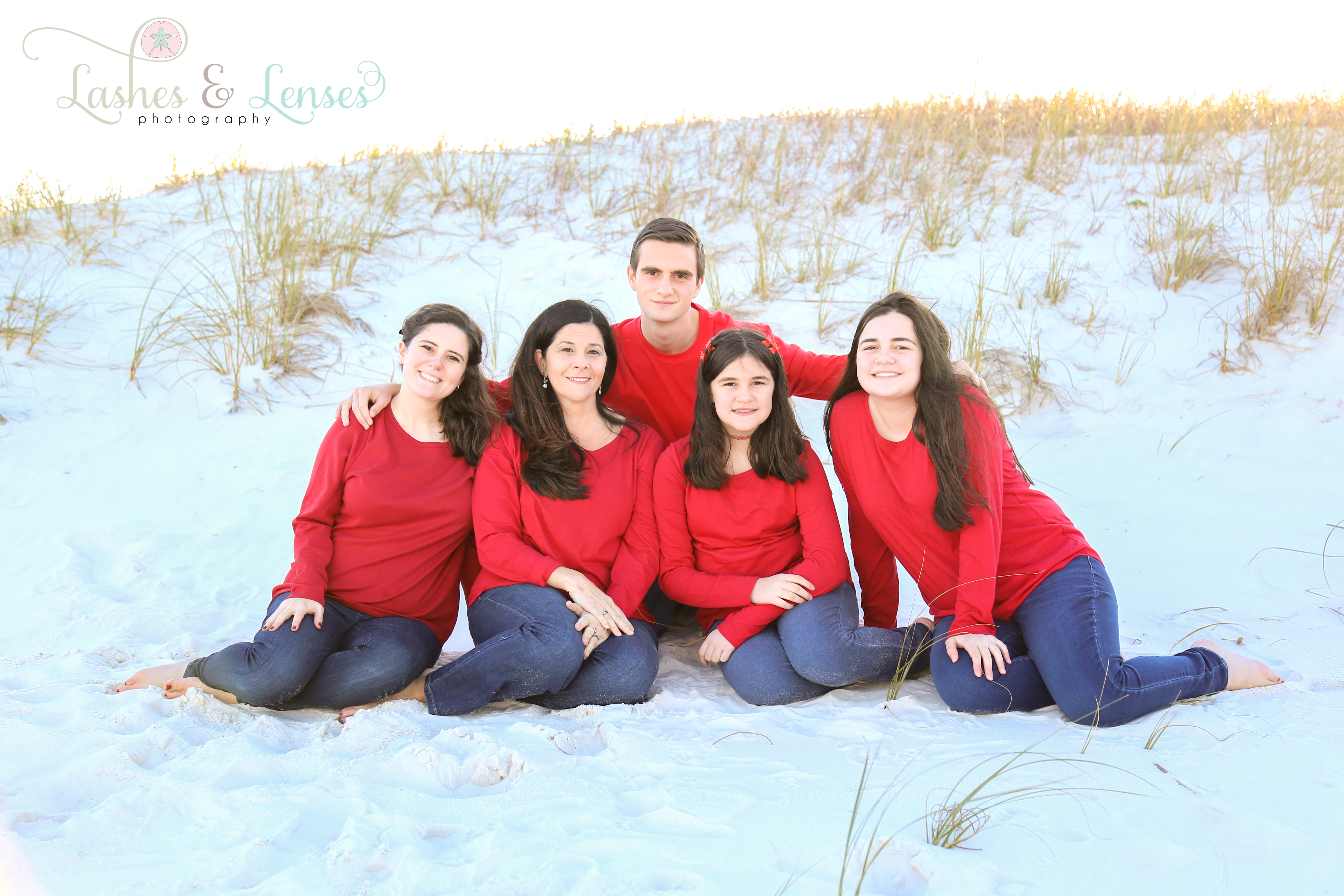 Mom and her four children sitting in the sand at Johnsons Beach in Perdido Key
